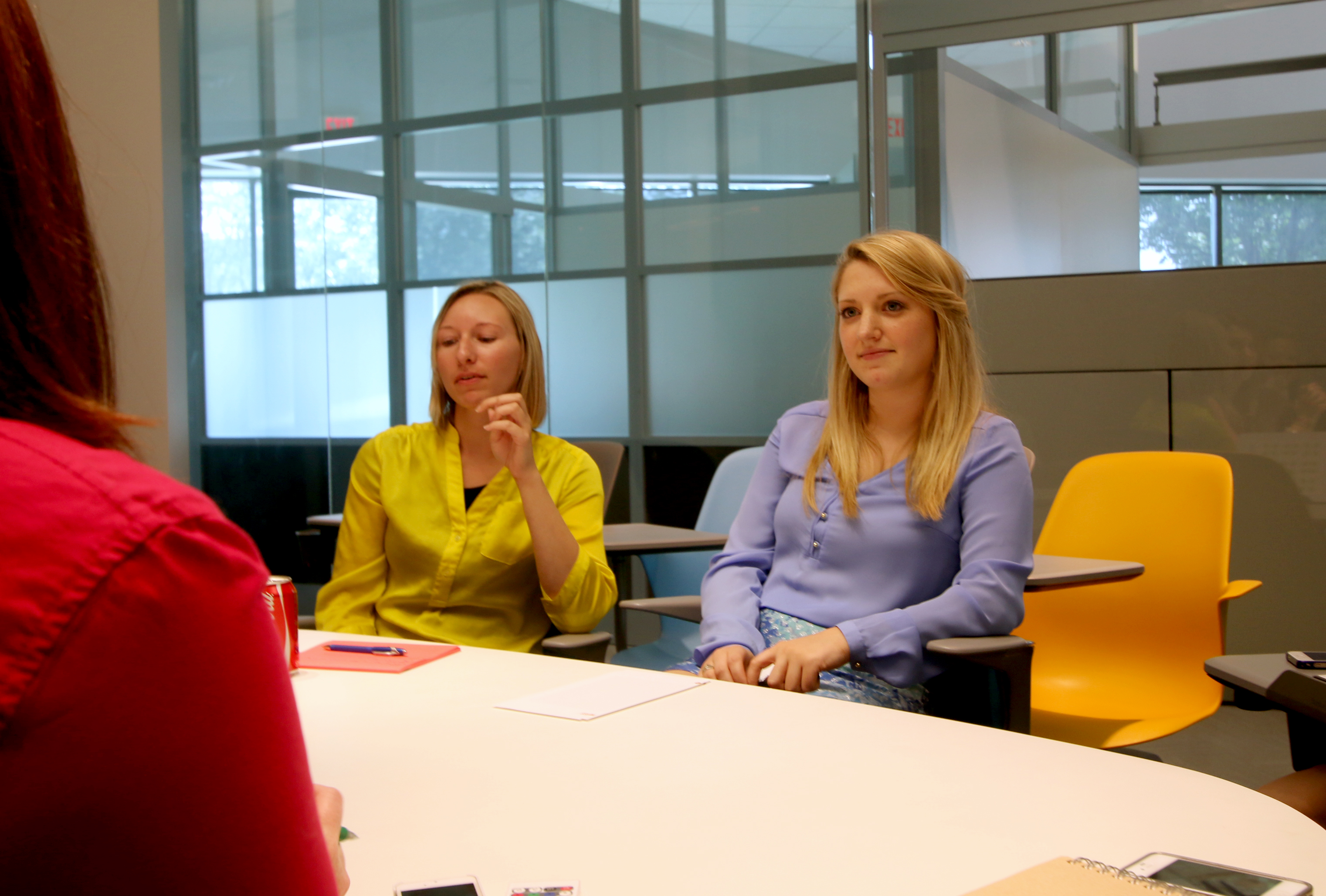 Rachel meeting with the other interior designers to discuss upcoming work.